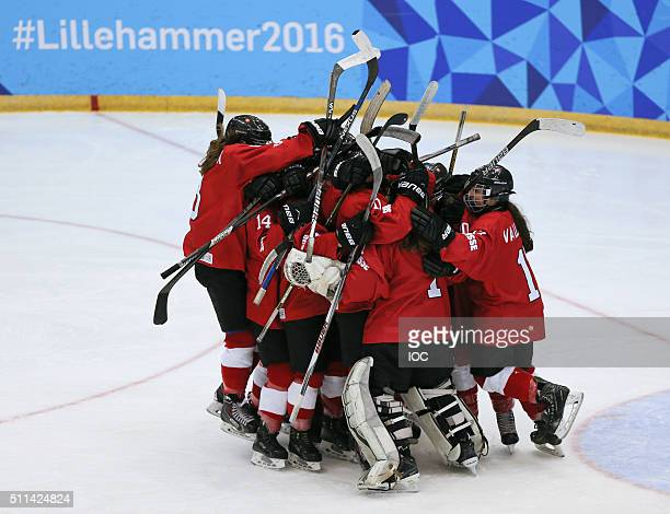 In this handout image supplied by the IOC, Switzerland gather together on the centre of the ice to celebrate their 5-2 win over Slovakia during the...