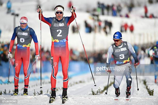 In this handout image supplied by the IOC Thomas Helland Larsen of Norway crosses the finish line to win the Gold Medal in the CrossCountry Skiing...