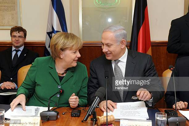 In this handout image supplied by the Israeli Government Press Office Israeli Prime Minister Benjamin Netanyahu and German Chancellor Angela Merkel...