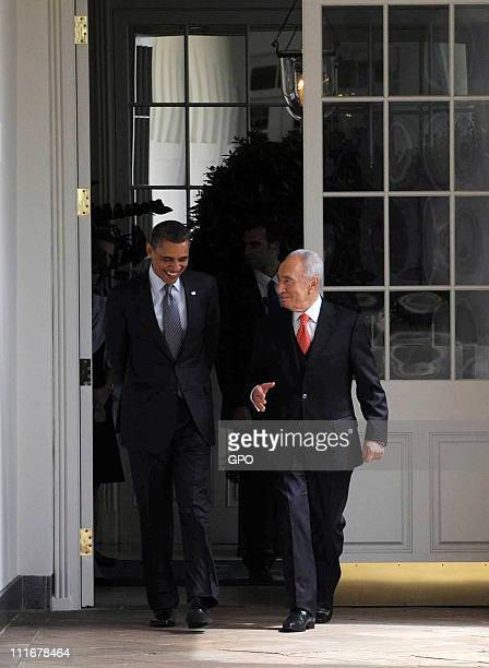 In this handout image supplied by the Israeli Government Press Office, U.S. President Barack Obama walks with Israeli President Shimon Peres at the...