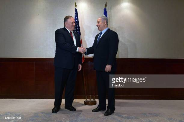 In this handout image supplied by the Israeli government press office , Israeli Prime Minister, Benjamin Netanyahu meets with US Secretary of State...