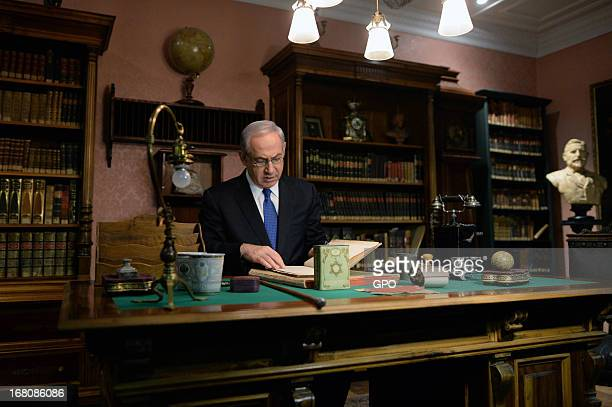In this handout image supplied by the Israeli Government press office Prime Minister Benjamin Netanyahu visits the Herzl Museum ahead of a cabinet...