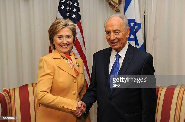 In this handout image supplied by the Israeli Government Press Office Israeli President Shimon Peres meets with Secretary of State Hillary Clinton on...