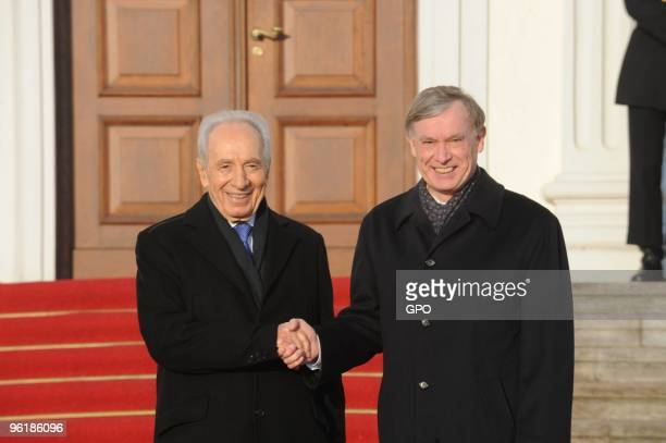 In this handout image supplied by the Israeli Government Press Office , German President Horst Koehler welcomes Israeli President Shimon Peres at the...