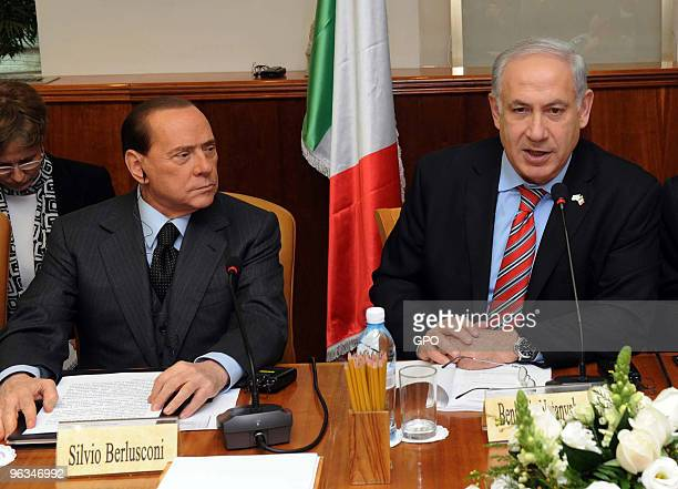 In this handout image supplied by the Israeli Government Press Office Israeli Prime Minister Benjamin Netanyahu and Italian Prime Minister Silvio...