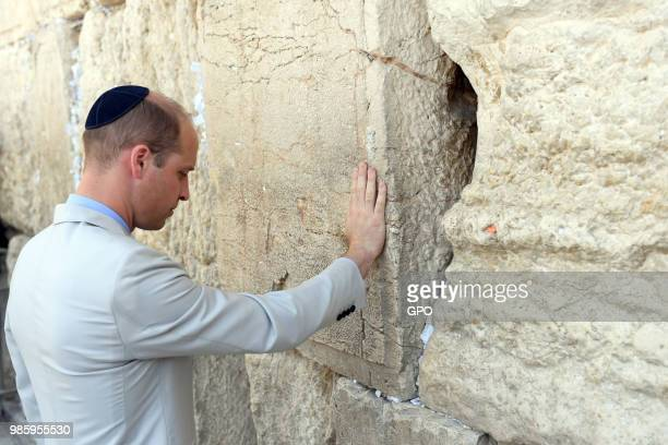 In this handout image supplied by the Israeli government press office Prince William Duke of Cambridge touches the Western Wall Judaism's holiest...