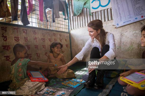 COX'S BAZAR BANGLADESH OCTOBER 23 In this handout image supplied by the Jordanian Royal Court Queen Rania of Jordan meets Rohingya muslim refugees...