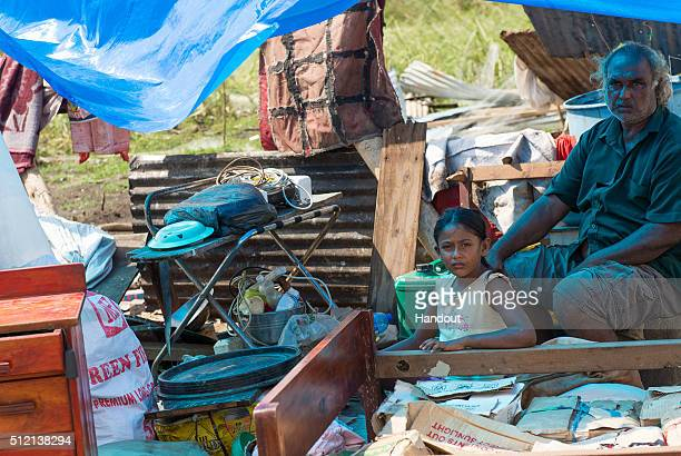 In this handout image supplied by the Mai Life Magazine Davendra Kumar and his niece are seen after they lost their home destroyed by Cyclone Winston...