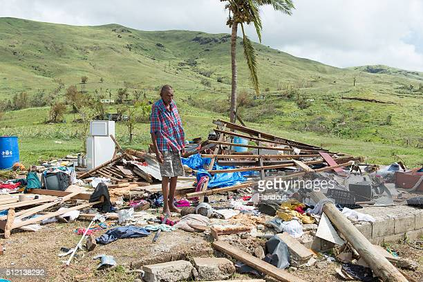 In this handout image supplied by the Mai Life Magazine Naresh Kumar of Tuvu Lautoka looks at the remains of his house after it was destroyed by...