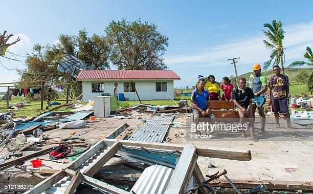 In this handout image supplied by the Mai Life Magazine the home of Asesela Sadola Fong and his family pose where their house was on February 22 2016...