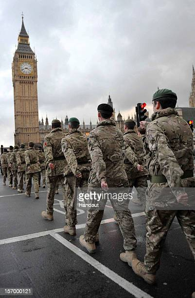 In this handout image supplied by the Ministry of Defence around 120 soldiers parade from Wellington Barracks to the Palace of Westminster to mark...