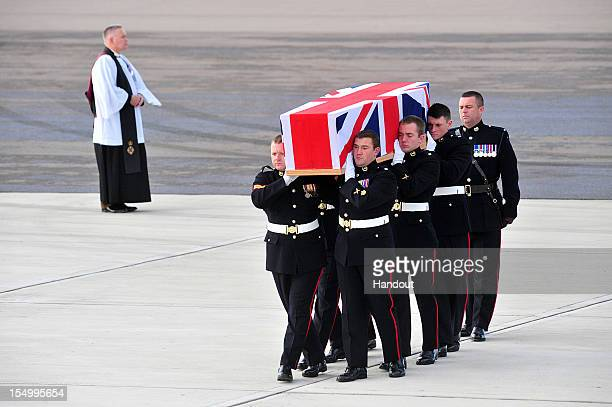 In this handout image supplied by the Ministry of Defence the repatriation ceremony takes place for Corporal David O'Connor from 40 Commando Royal...