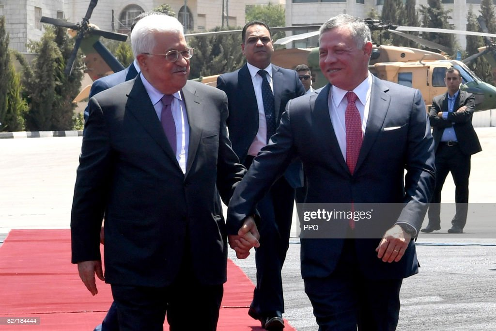 In this handout image supplied by the office of the Palestinian president, King Abdullah II of Jordan is greeted by Palestinian President Mahmoud Abbas during his visit on August 7, 2017 in Ramallah, West Bank.