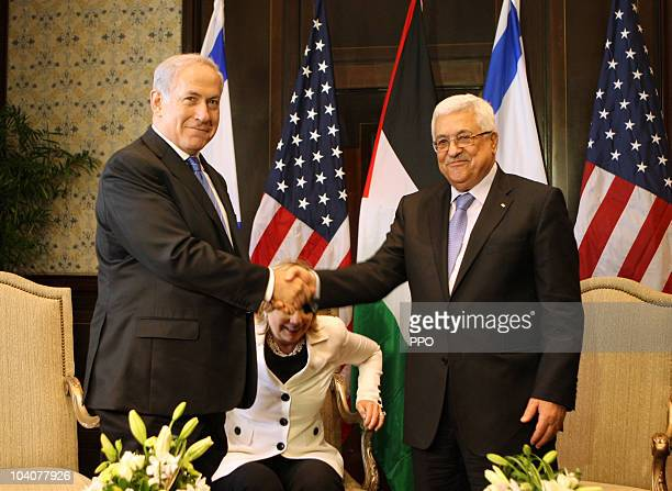In this handout image supplied by the Office of the Palestinian President President Mahmoud Abbas and Israeli Prime Minister Benjamin Netanyahu...