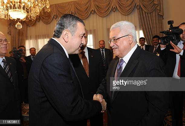 In this handout image supplied by the office of the Palestinian President President Mahmoud Abbas meets Egyptian Prime Minister Essam Sharaf on April...