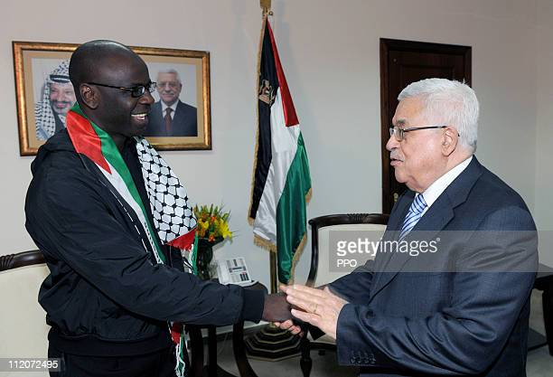In this handout image supplied by the Office of the Palestinian President President Palestinian President Mahmoud Abbas meets with French footballer...