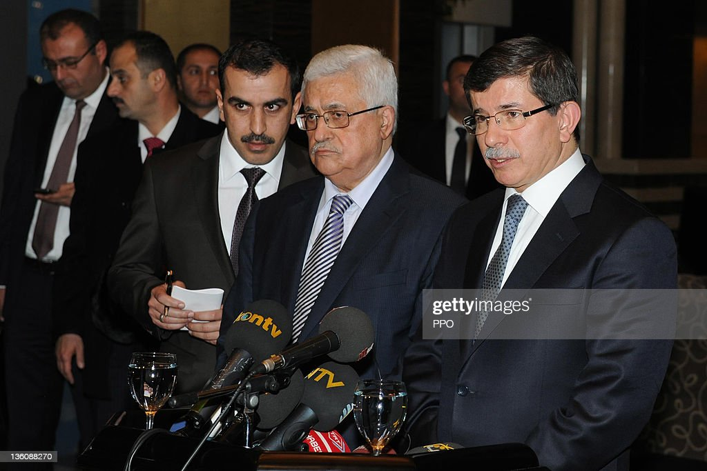 In this handout image supplied by the office of the Palestinian President (PPO), Palestinian President Mahmoud Abbas (C) at a press conference with Turkish Foreign Minister Ahmet Davutoglu (R) on December 19, 2011 in Konya, Turkey. Abbas was in Turkey to meet with officials to discuss measures for recognition of the Palestinian state.