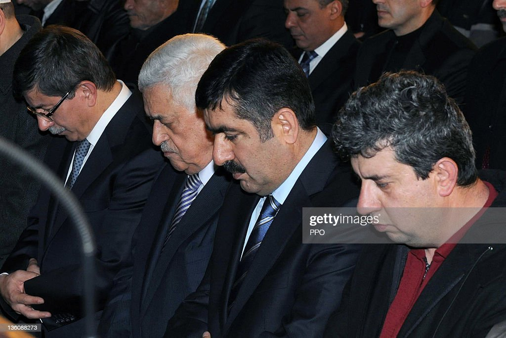 In this handout image supplied by the office of the Palestinian President (PPO), Palestinian President Mahmoud Abbas (2L) accompanied by Turkish Foreign Minister Ahmet Davutoglu (L) attend mosque services on December 19, 2011 in Konya, Turkey. Abbas was in Turkey to meet with officials to discuss measures for recognition of the Palestinian state.