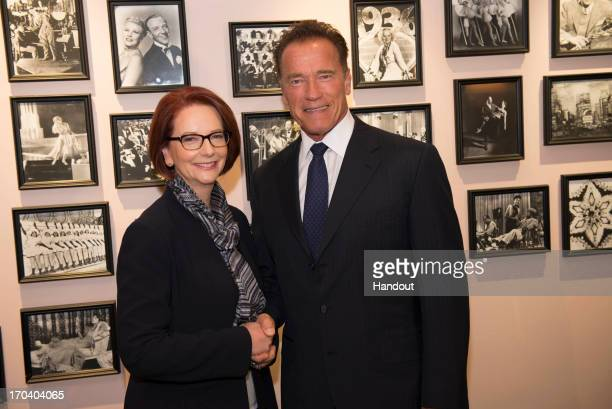 In this handout image supplied by the Office of the Prime Minister Arnold Schwarzenegger meets with Australian Prime Minister Julia Gillard on June...