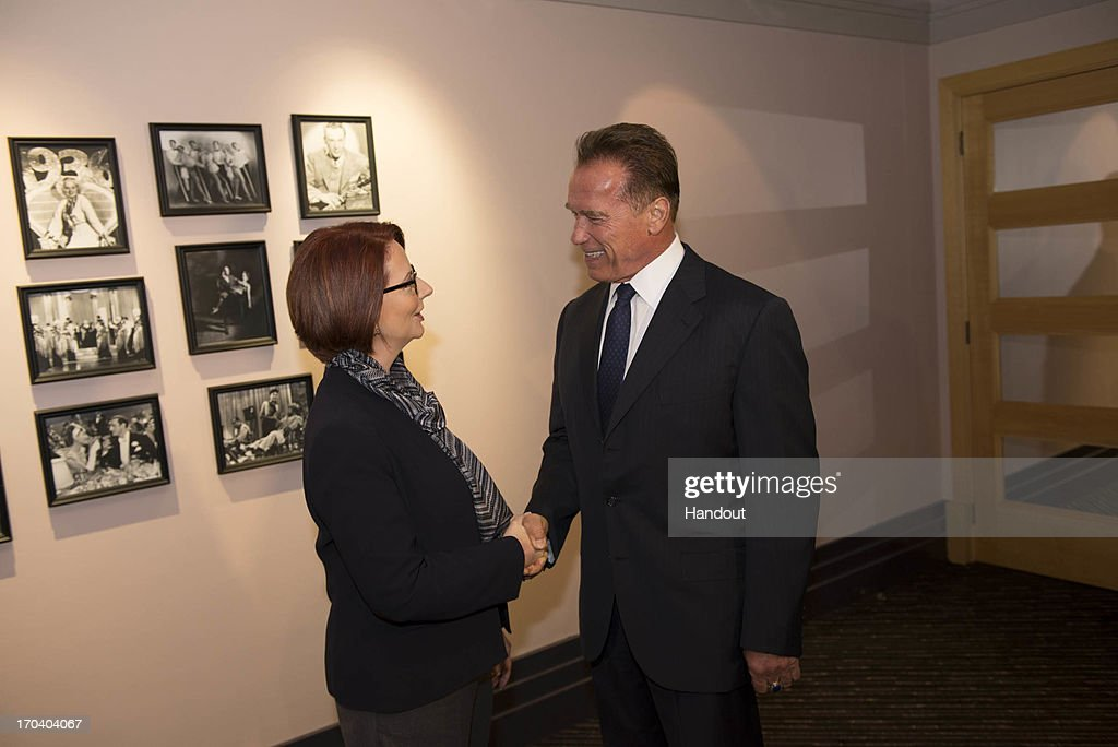 In this handout image supplied by the Office of the Prime Minister, Arnold Schwarzenegger meets with Australian Prime Minister, Julia Gillard, on June 13, 2013 in Perth, Australia. Gillard and Schwarzenegger discussed climate change and the experience that the former Californian governor had when he put a price on carbon.