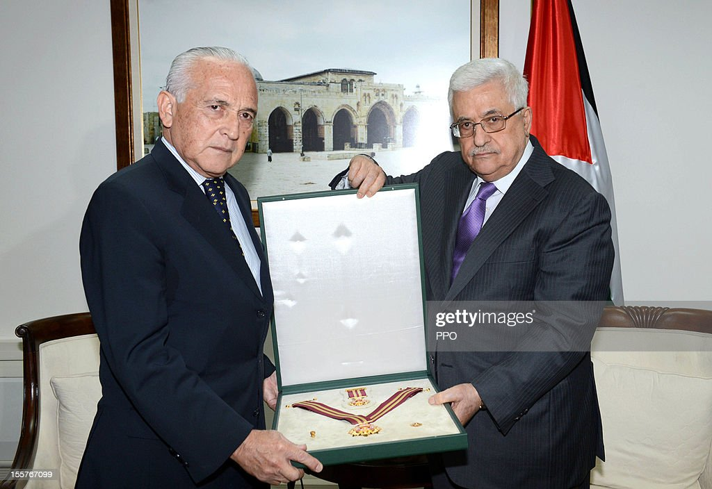 In this handout image supplied by the Palestinian President's Office (PPO), Palestinian President Mahmoud Abbas (R) grants Argentina's Representative Horacio Wamba the Star of Jerusalem November 8, 2012 in Ramallah, West Bank. Yesterday Abbas congratulated U.S. President Barack Obama on his re-election and urged him to help instate a two-state solution in the Middle East.