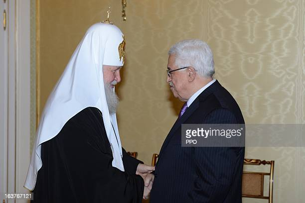 In this handout image supplied by the Palestinian Presidents Office Palestinian President Mahmoud Abbas shakes hands with Russian Orthodox Patriarch...