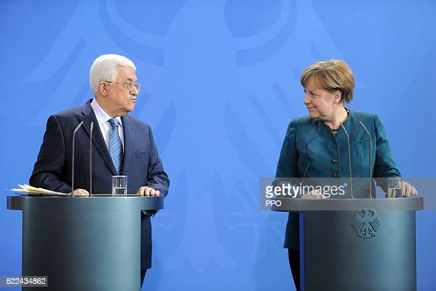 In this handout image supplied by the Palestinian President's Office Palestinian President Mahmoud Abbas attends a press conference with German...