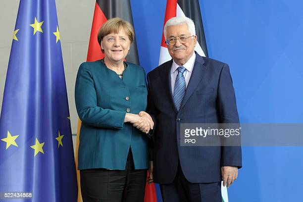 In this handout image supplied by the Palestinian President's Office Palestinian President Mahmoud Abbas shakes hands with German Chancellor Angela...