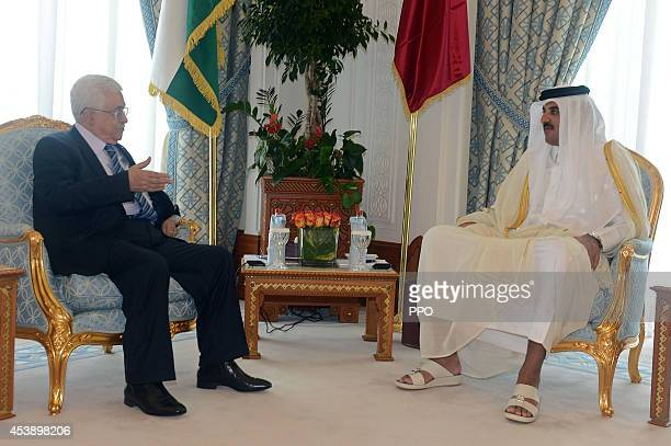 In this handout image supplied by the Palestinian Press Office President Mahmoud Abbas talks with the Emir of Qatar Sheikh Tamim during their meeting...