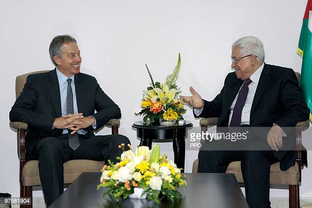 In this handout image supplied by the Palestinian Press Office Palestinian President Mahmoud Abbas speaks with former British Prime Minister and...