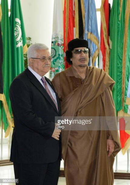 In this handout image supplied by the Palestinian Press Office Palestinian President Mahmoud Abbas greets Libyan leader Muammar Gaddafi on the first...