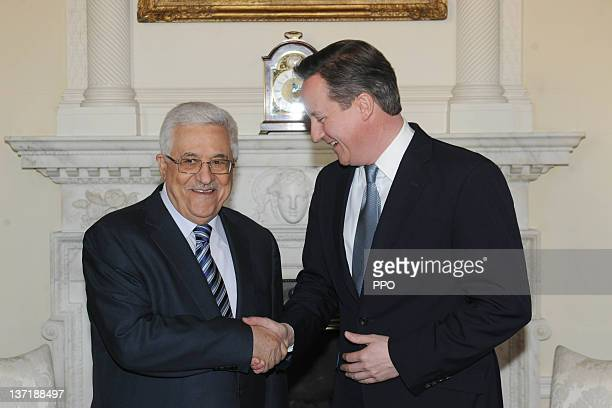 In this handout image supplied by the Palestinian Press Office Britain's Prime Minister David Cameron shakes hands with Palestinian Authority...
