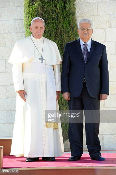 In this handout image supplied by the Palestinian Press Ofiice Palestinian President Mahmoud Abbas stands with Pope Francis during a welcoming...