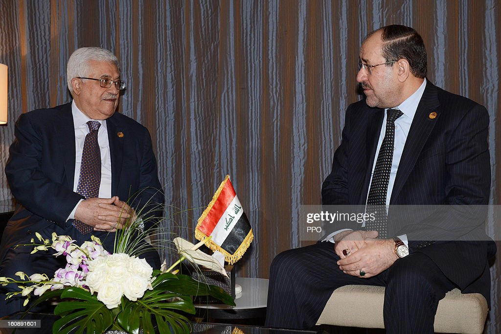 In this handout image supplied by the PPO (Palestinian Presidents Office), Palestinian President Mahmoud Abbas attends a meeting with Iraqi Prime Minister Nuri al-Maliki during an Islamic Summit on February 6, 2013 in Cairo, Egypt. The leaders of 56 Islamic states are gathering in Cairo for a meeting of the Organisation of Islamic Co-Operation (OIC), which will focus on the Syrian crisis.
