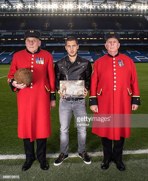 In this handout image supplied by The Premier League on May 8 Chelsea and Belgium midfielder Eden Hazard helps launch the Football Remembers Schools...