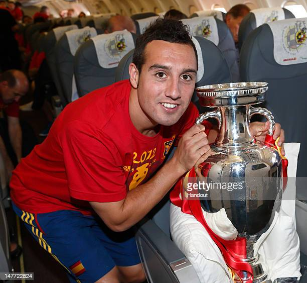 In this handout image supplied by the Royal Spanish Football Federation Santi Cazorla of Spain poses with the trophy following his team's victory in...