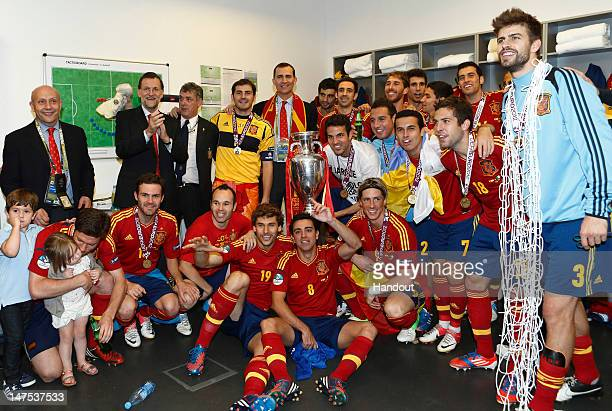 In this handout image supplied by the Royal Spanish Football Federation Spanish president Mariano Rajoy and Prince Felipe of Spain celebrate with the...