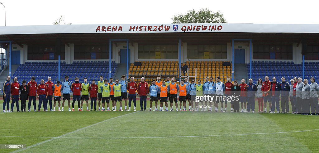 In this handout image supplied by the Royal Spanish Football Federation, the Spain team observe a minute's silence for recently appointed Villarreal Coach Manuel Preciado, who died today aged 54, at Arena Mistrzow on June 7, 2012 in Gniewino, Poland.