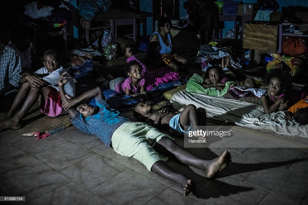 In this handout image supplied by the UNICEF, children and their parents prepare for another night in evacuation centre in Ba town on February 24, 2016 on Viti Levu Island of Fiji. Category 5 Tropical Cyclone Winston made landfall in Fiji on Saturday 20 February, continuing its path of destruction into Sunday 21 February. A state of natural disaster and a nationwide curfew had been declared by the Government of Fiji earlier in the evening. The Fijian Government has declared a state of natural disaster for the next 30 days and has initiated the clean-up process by clearing the huge amounts of debris scattered everywhere.