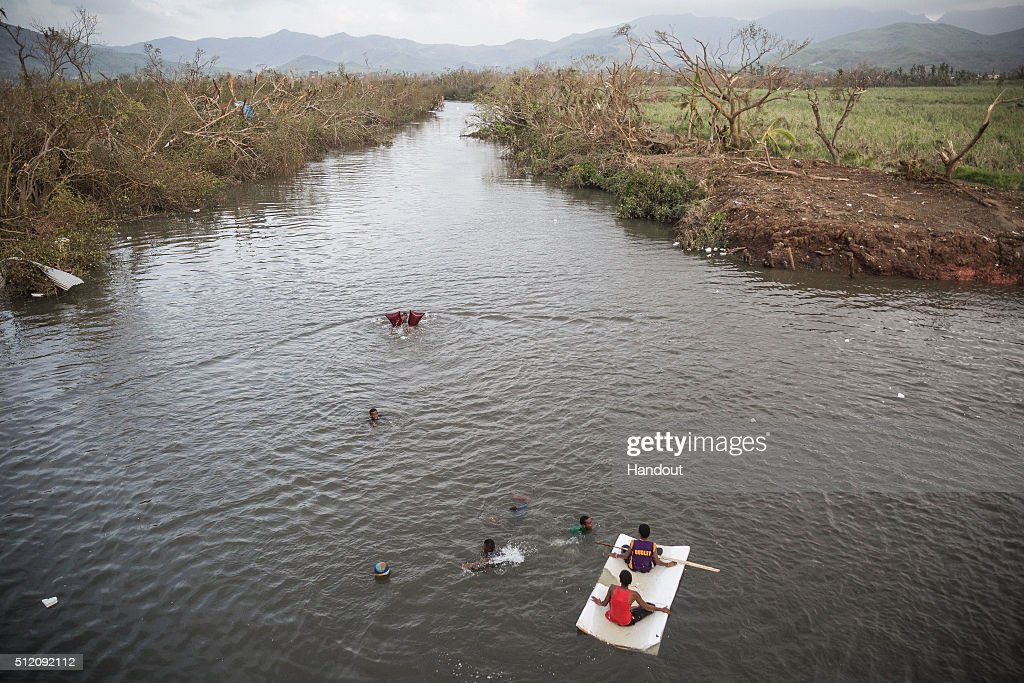 In this handout image supplied by the UNICEF, children play on the Rakiraki river near Rakiraki Village on February 24, 2016 in Fiji. Category 5 Tropical Cyclone Winston made landfall in Fiji on Saturday 20 February, continuing its path of destruction into Sunday 21 February. A state of natural disaster and a nationwide curfew had been declared by the Government of Fiji earlier in the evening. The Fijian Government has declared a state of natural disaster for the next 30 days and has initiated the clean-up process by clearing the huge amounts of debris scattered everywhere.