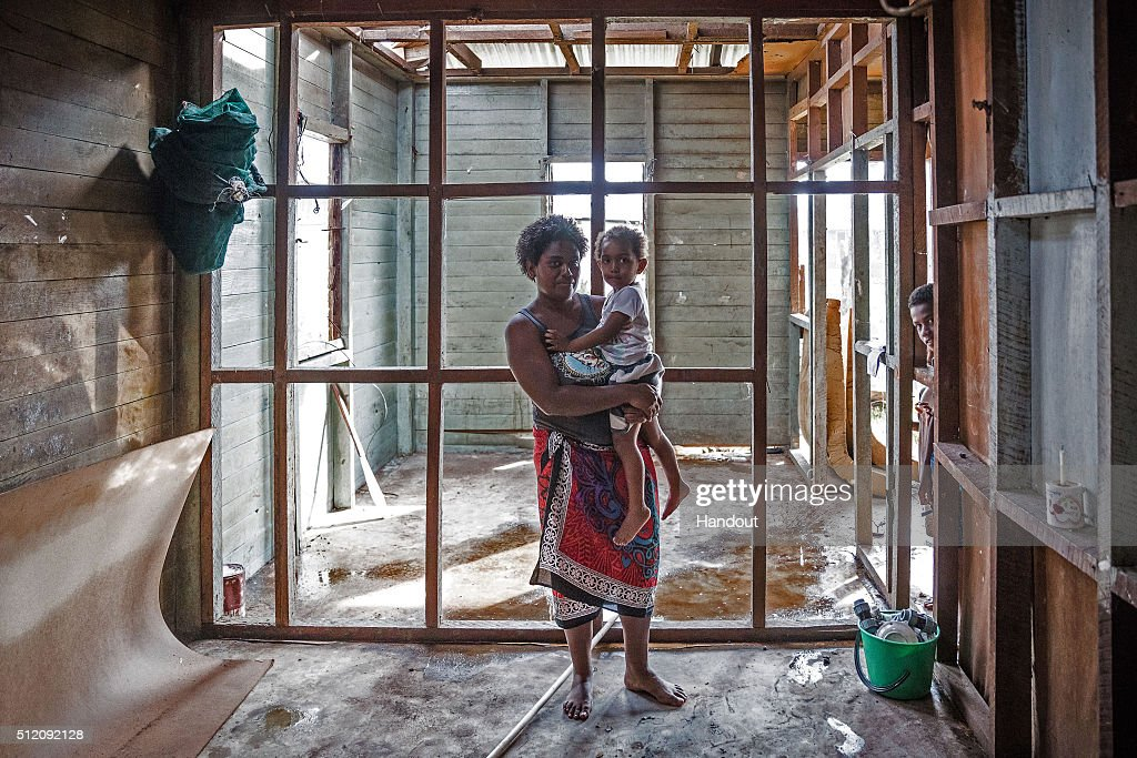In this handout image supplied by the UNICEF, Kolora, 26, holds her daughter Semaima, 2, in what is left of her home in the aftermath of Tropical Cyclone Winston in Rakiraki district in Ra province on February 24, 2016 in Fiji. Category 5 Tropical Cyclone Winston made landfall in Fiji on Saturday 20 February, continuing its path of destruction into Sunday 21 February. A state of natural disaster and a nationwide curfew had been declared by the Government of Fiji earlier in the evening. The Fijian Government has declared a state of natural disaster for the next 30 days and has initiated the clean-up process by clearing the huge amounts of debris scattered everywhere.