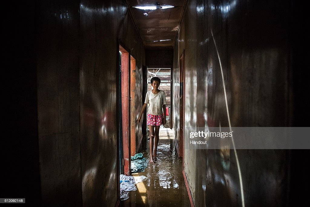 In this handout image supplied by the UNICEF, Makereta Nasiki, 13, stands in a corridor of her home, in the aftermath of Cyclone Winston in Ba town, on February 24, 2016 on Viti Levu Island of Fiji. Category 5 Tropical Cyclone Winston made landfall in Fiji on Saturday 20 February, continuing its path of destruction into Sunday 21 February. A state of natural disaster and a nationwide curfew had been declared by the Government of Fiji earlier in the evening. The Fijian Government has declared a state of natural disaster for the next 30 days and has initiated the clean-up process by clearing the huge amounts of debris scattered everywhere.