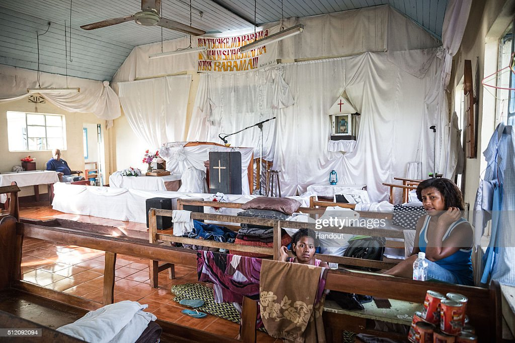 In this handout image supplied by the UNICEF, Micola, 18, (L) and Lusiana, 17 (R) sit in an evacuation centre in Ra Province, Viti Levu Island on February 24, 2016 in Fiji. Category 5 Tropical Cyclone Winston made landfall in Fiji on Saturday 20 February, continuing its path of destruction into Sunday 21 February. A state of natural disaster and a nationwide curfew had been declared by the Government of Fiji earlier in the evening. The Fijian Government has declared a state of natural disaster for the next 30 days and has initiated the clean-up process by clearing the huge amounts of debris scattered everywhere.