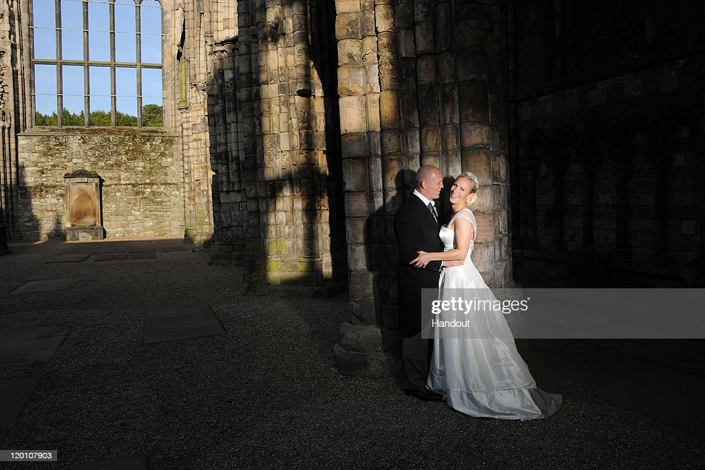 In this handout image supplied by Zara Phillips and Mike Tindall, England rugby captain Mike Tindall and Zara Phillips are pictured in Holyrood Abbey, Palace of Holyroodhouse after their marriage at Canongate Kirk on July 30, 2011 in Edinburgh, Scotland. The Queen's granddaughter Zara Phillips will marry England rugby player Mike Tindall today at Canongate Kirk. Many royals are expected to attend including the Duke and Duchess of Cambridge.