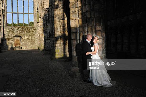 In this handout image supplied by Zara Phillips and Mike Tindall England rugby captain Mike Tindall and Zara Phillips are pictured in Holyrood Abbey...