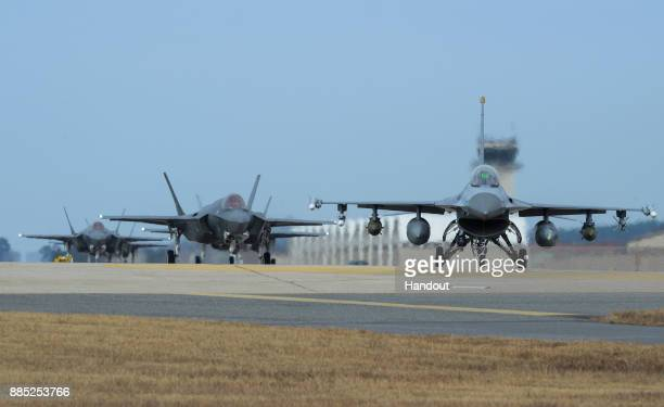 In this handout image taken on December 3 by US Air Force and released on December 4 US Air Force F16 Fighting Falcon and F35A Lightning II fighter...