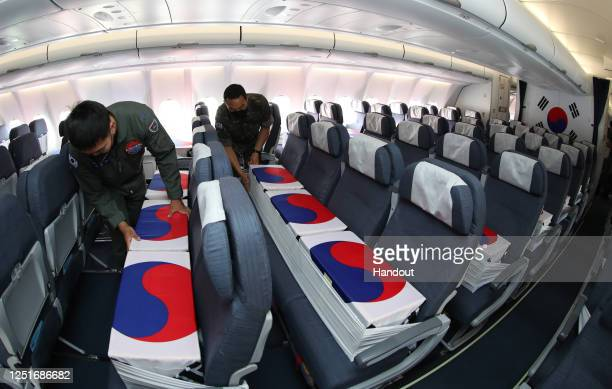 In this handout image taken on June 23, 2020 and provided by South Korean Defense Ministry, South Korean soldiers setting coffins containing the...