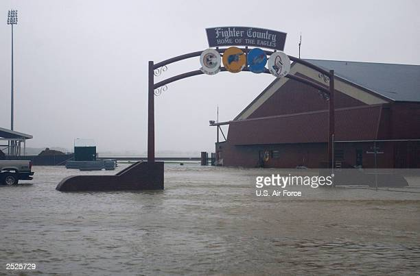 In this handout image the 'Fighter Country' arch a primary entrance to the flightline at Langley Air Force Base is flooded as Hurricane Isabel blows...