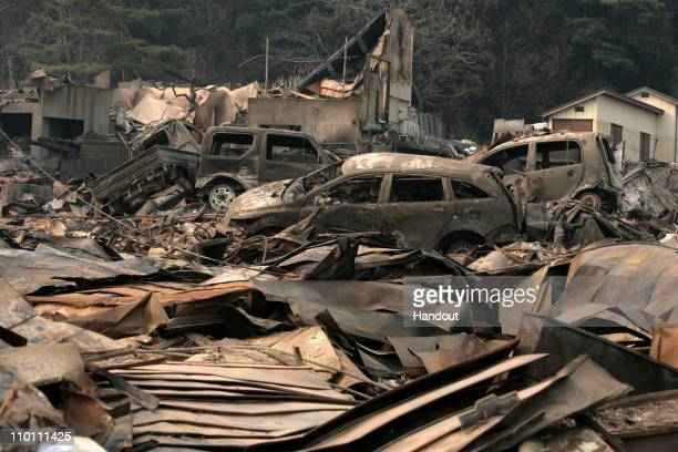 In this handout images provided by the International Federation of Red Cross Japan, A general view is seen of what is left of the city after a...