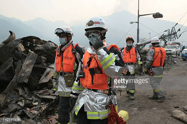 In this handout images provided by the International Federation of Red Cross Japan Fire fighters from the Osaka Prefecture in West Japan have also...